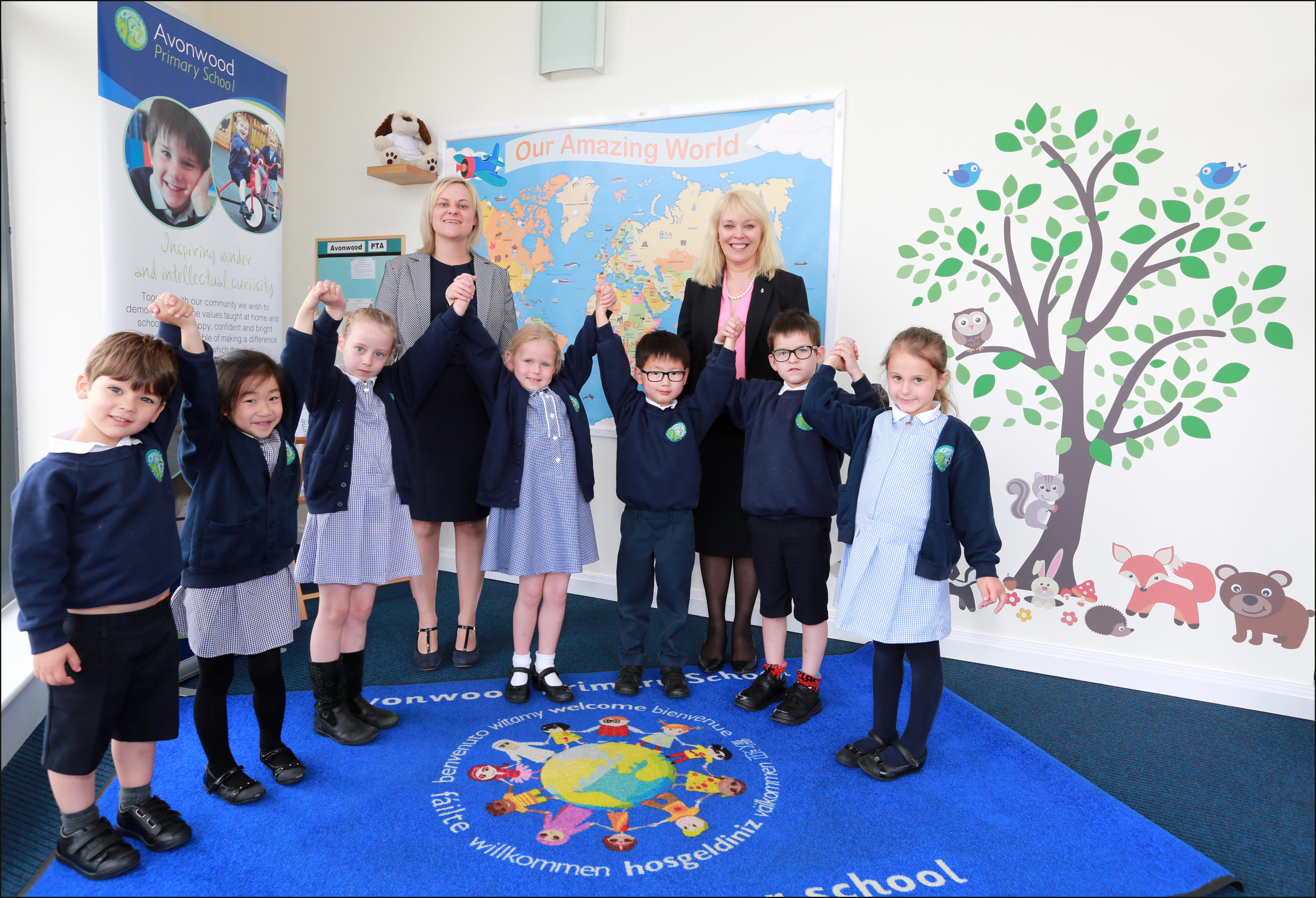 Avonwood Primary School has achieved Earth Charter status. Head Annie Dowling and Avonbourne Trust CEO Debbie Godfrey-Phaure are pictured with pupils.